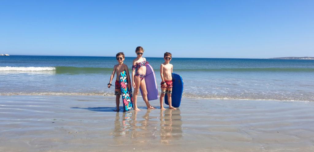 Kids having boogie board fun on Paternoster beach
