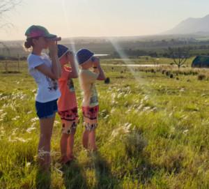 Kids looking through binoculars at Kwetu Guest Farm