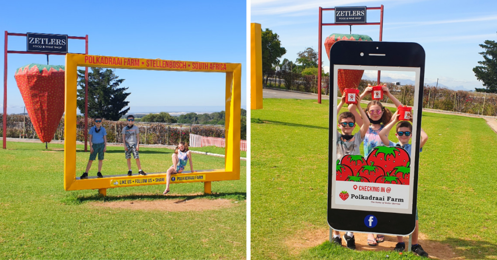 Kids at Polkadraai Strawberry farm in Stellenbosch posing on the yellow photo frame and mobile phone frame.