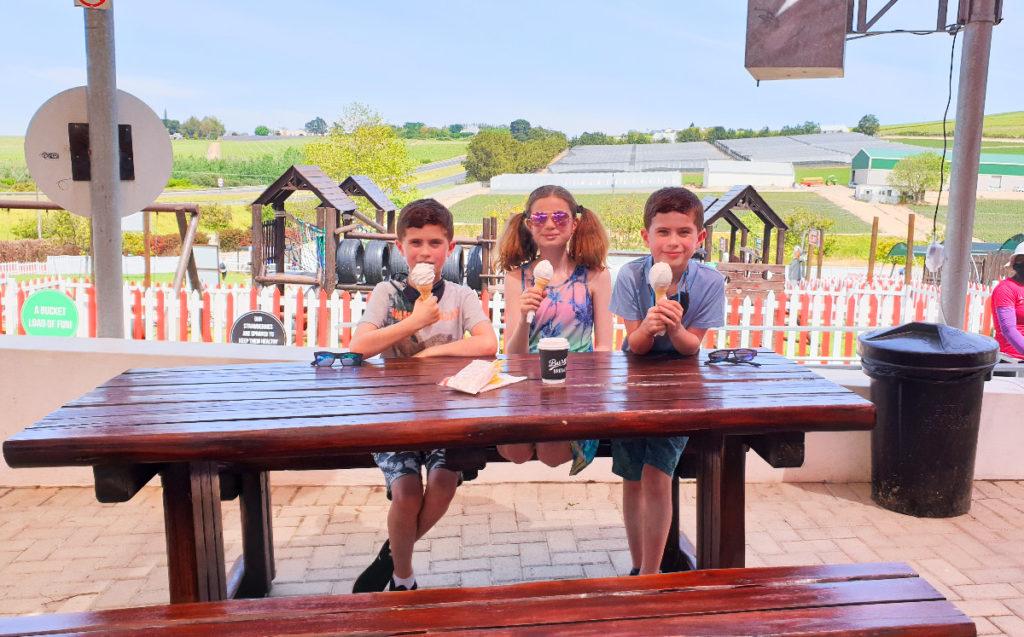 Kids eating soft serves at Polkadraai Strawberry Farm