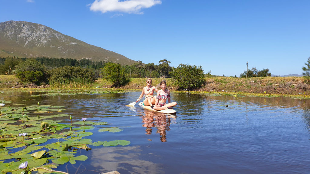Mom and daughter paddling on dam at Stanford Hills Estate