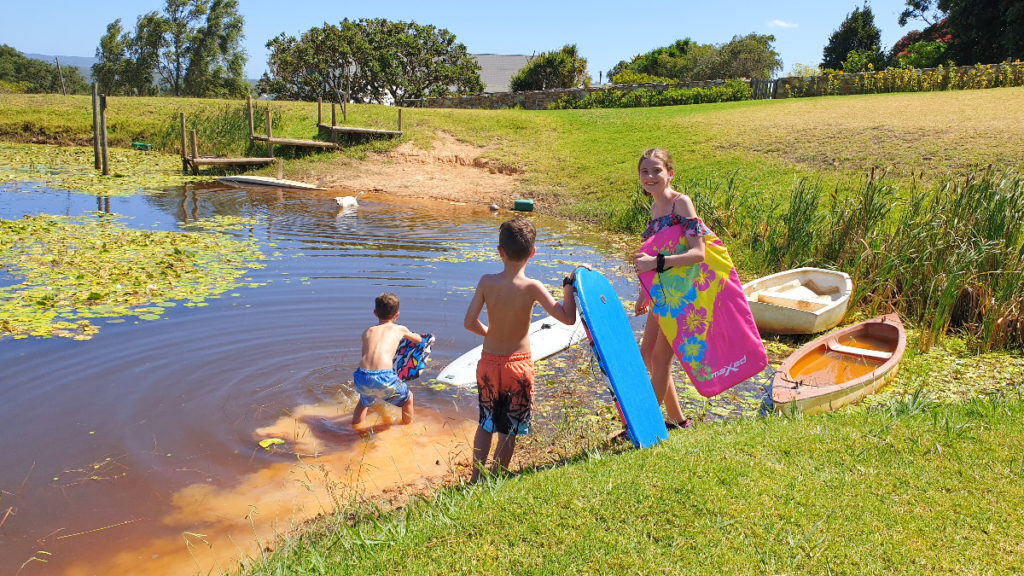 Kids playing on the banks of the dam at Stanford Hills Estate
